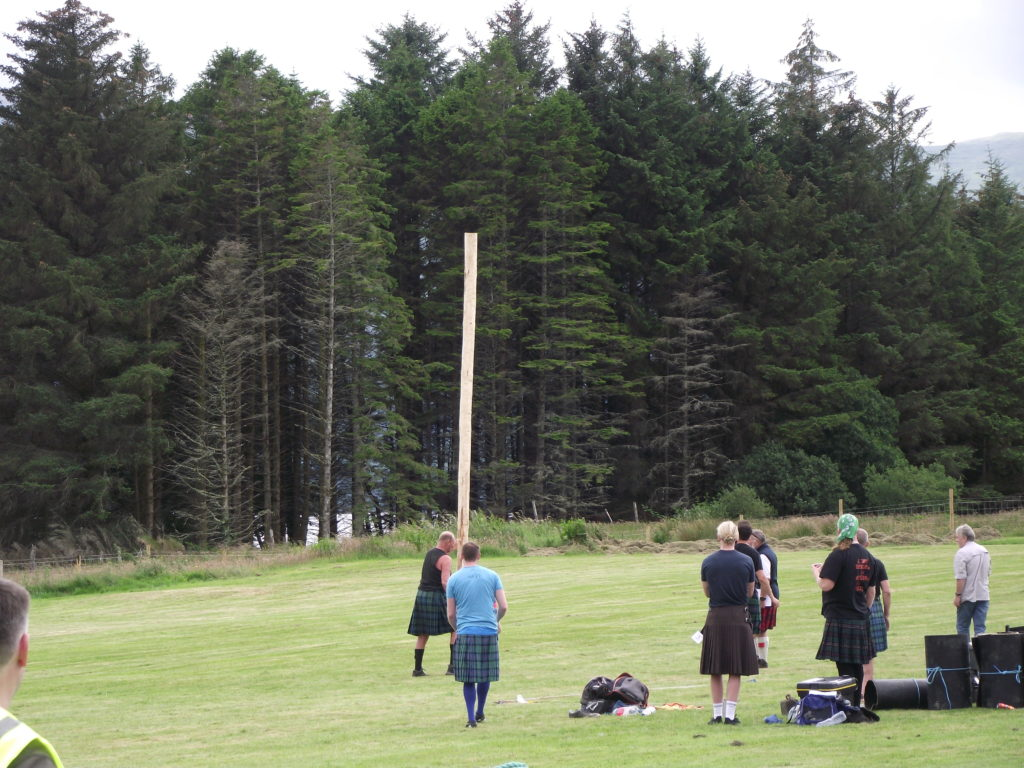 The caber toss drew interested spectators.  NO F29 caber