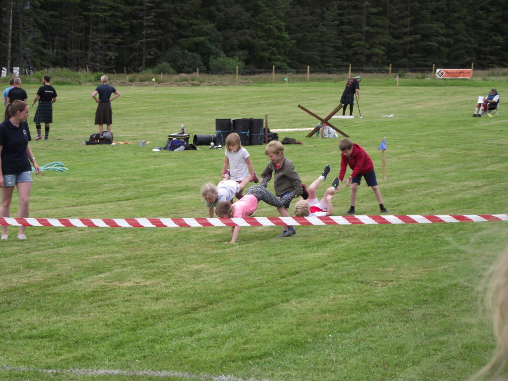 Fun at the wheelbarrow race.  NO F29 wheelbarrow