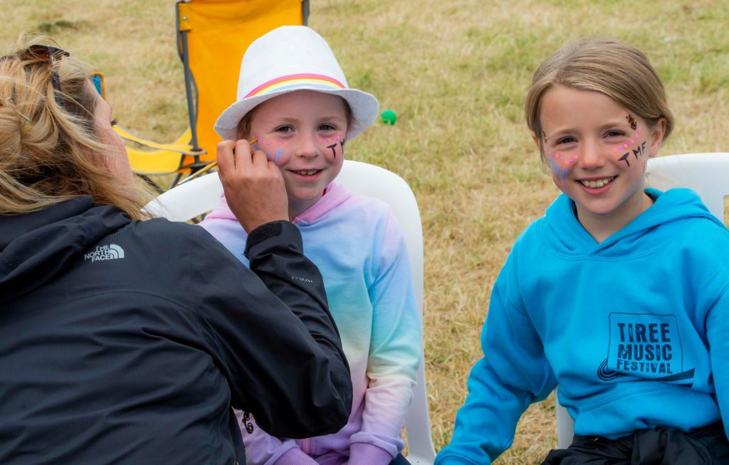 Face painting fun on the festival field at Tiree. Photograph: Alan Peebles