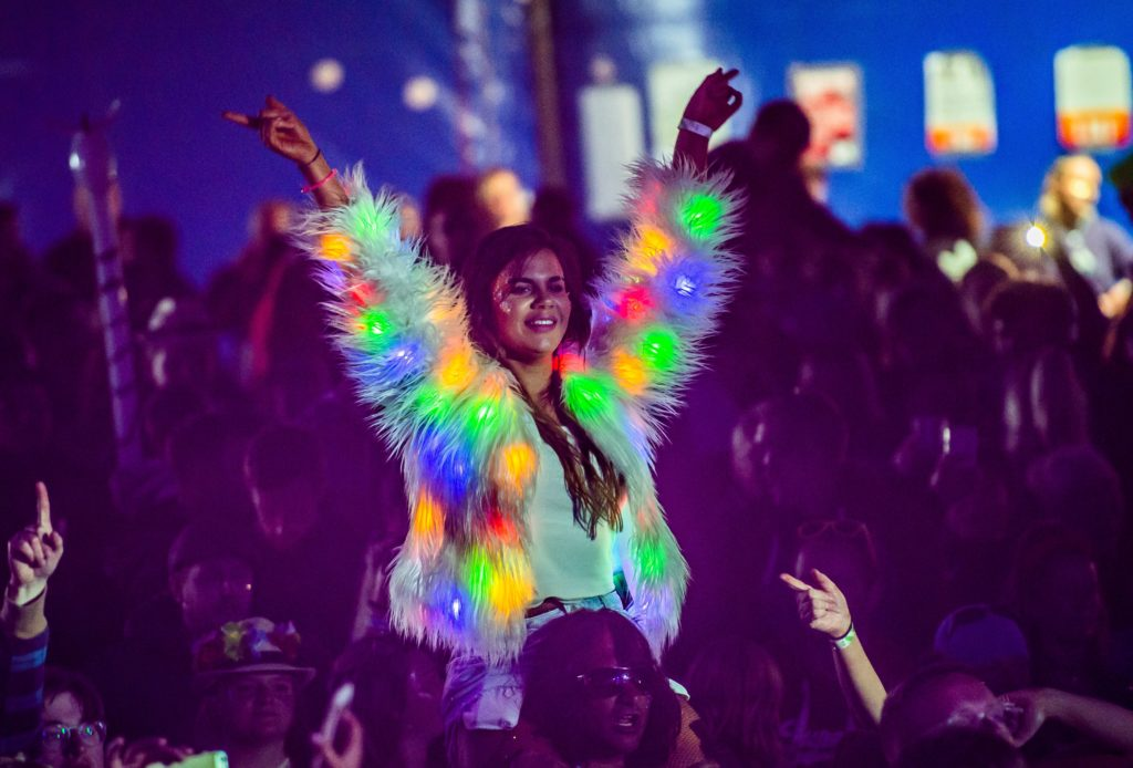 Glow girl shines out in the TMF crowd. Photograph: Alan Peebles