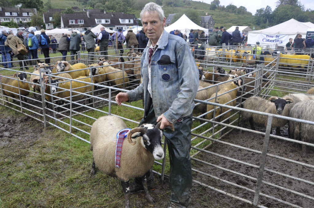 James Weir, from Angus, with his champion Blackface ewe.