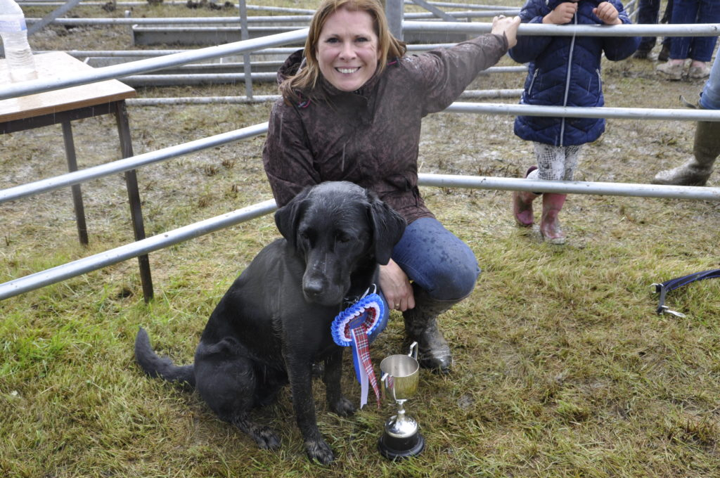 Brue, with owner Jenne Singer, won the best dog in show.