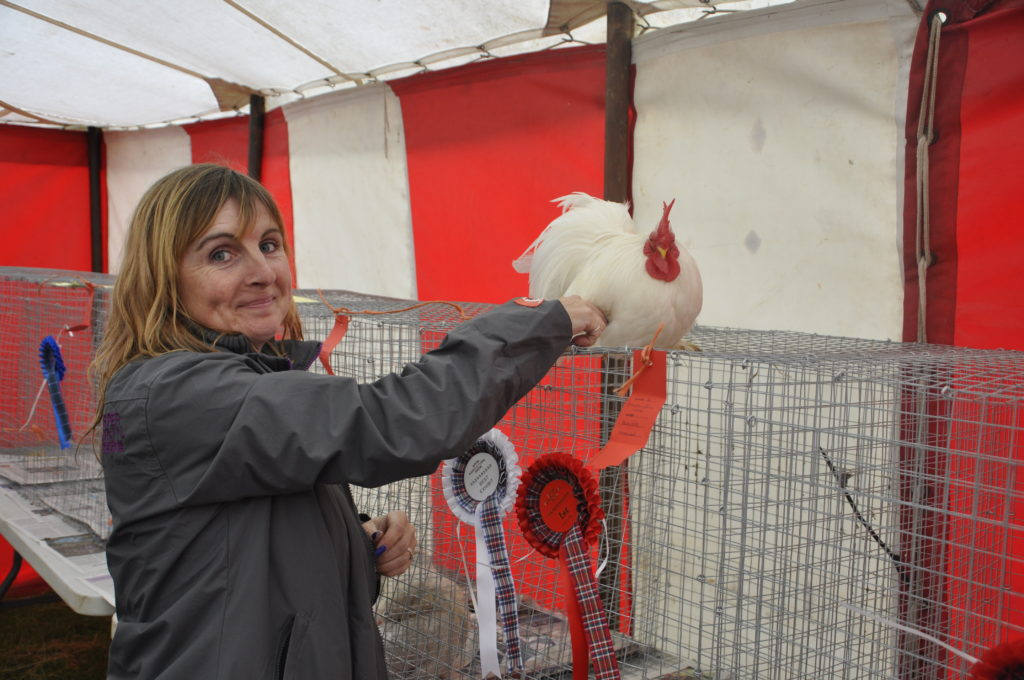 Jennifer MacNeil from Bonawe, pictured here with her white Peking cockerel Romeo, had a clean sweep in the poultry section.