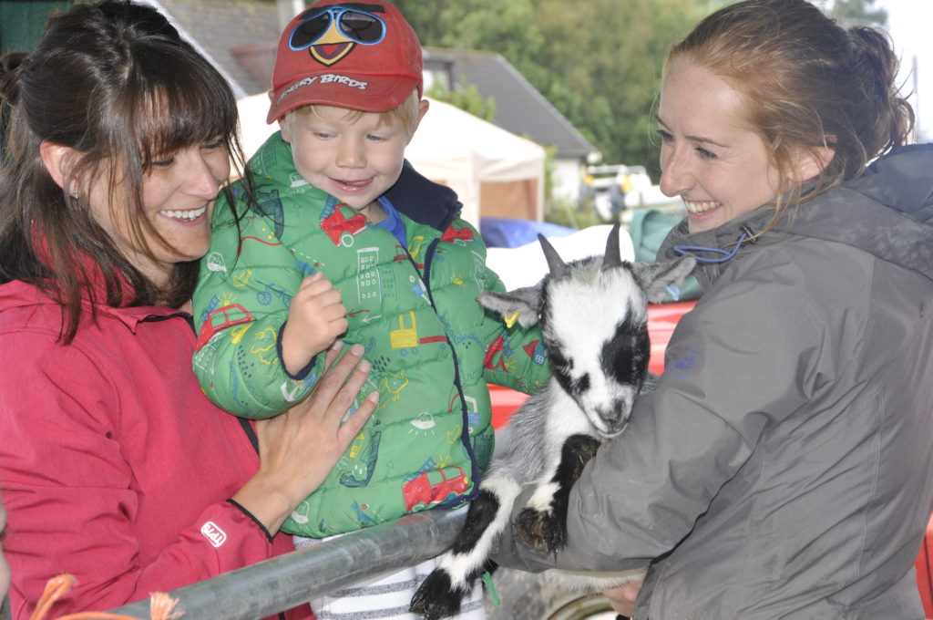 Young Brodie Johnston just loved getting up close to Cloudy the pygmy goat along with his mum Alice.