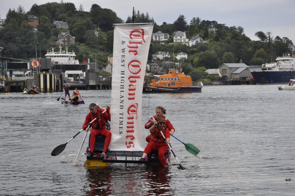The Oban Times team Red All Over sails into Oban Bay flying the masthead. 15_T35_RaftRace13