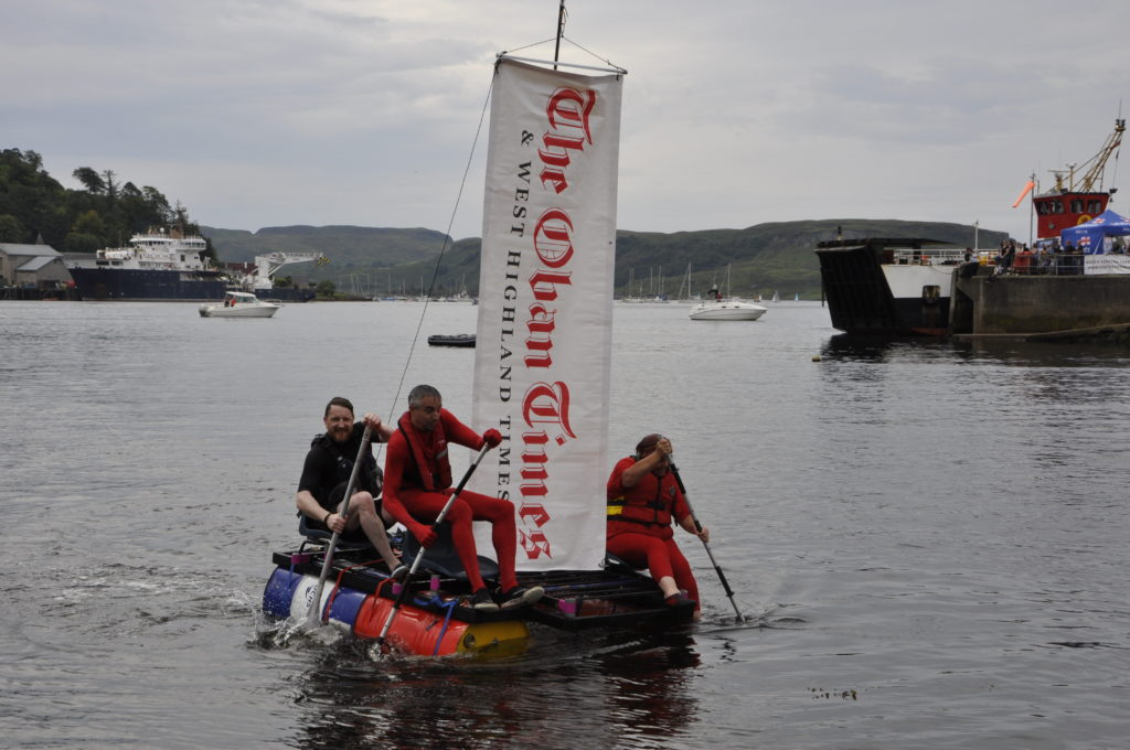 The Oban Times team Red All Over sails into Oban Bay flying the masthead. 15_T35_RaftRace14