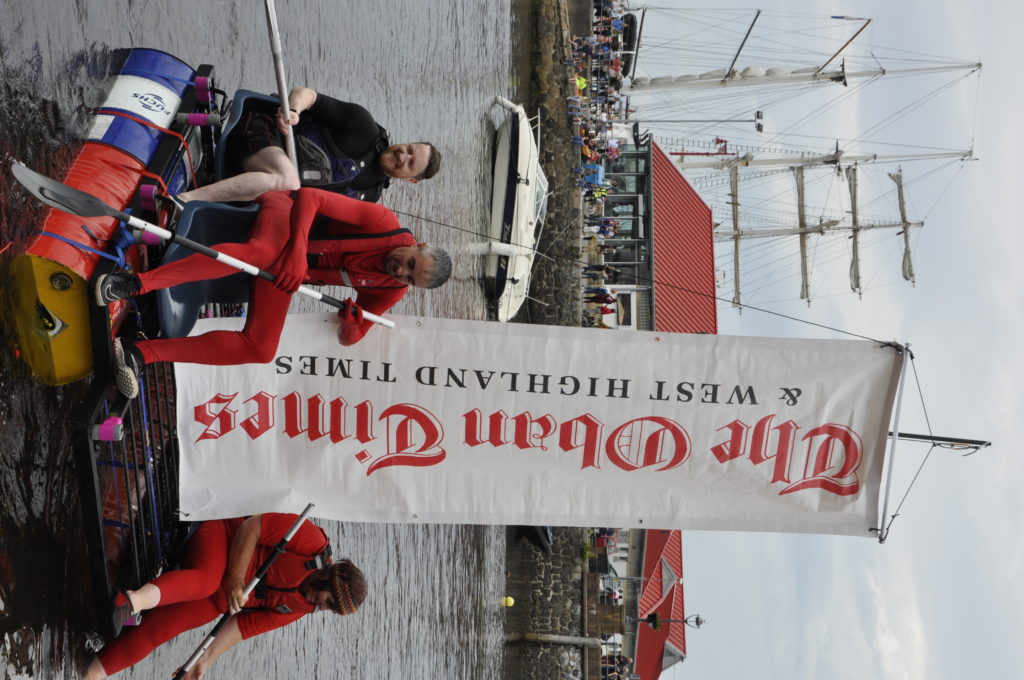 The Oban Times team Red All Over sails into Oban Bay flying the masthead. 15_T35_RaftRace15