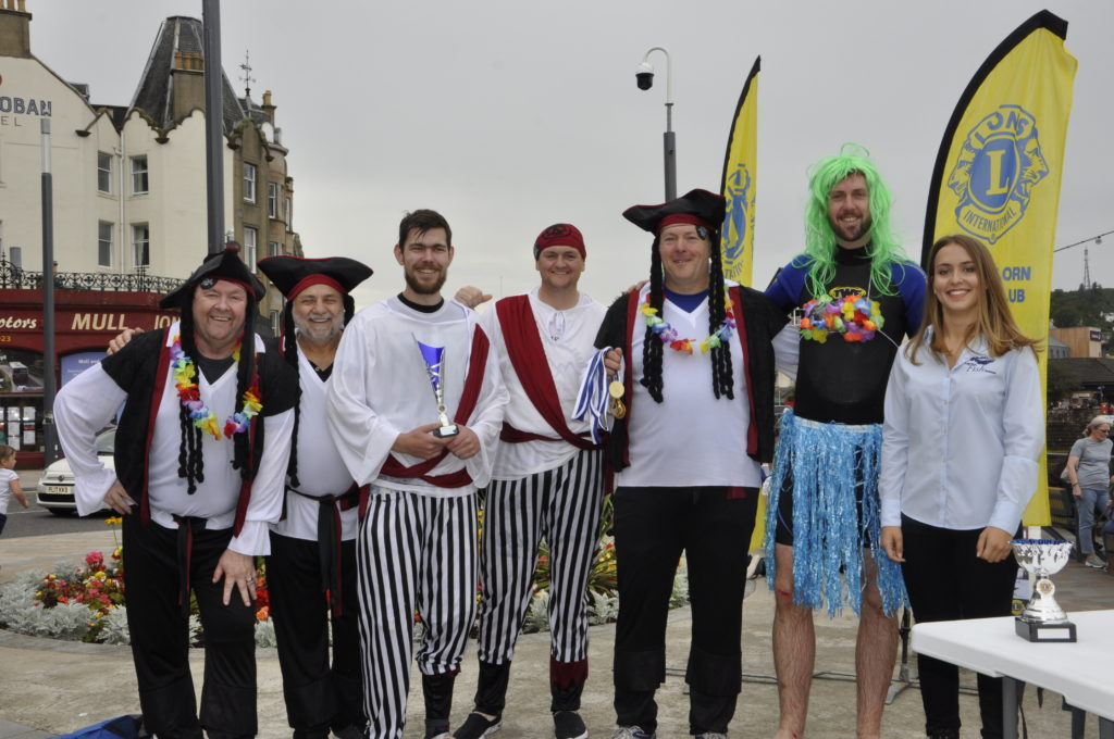 Martyn's Monday Club's Oban Bay Pirates pick up their medals. 15_T35_RaftRace20
