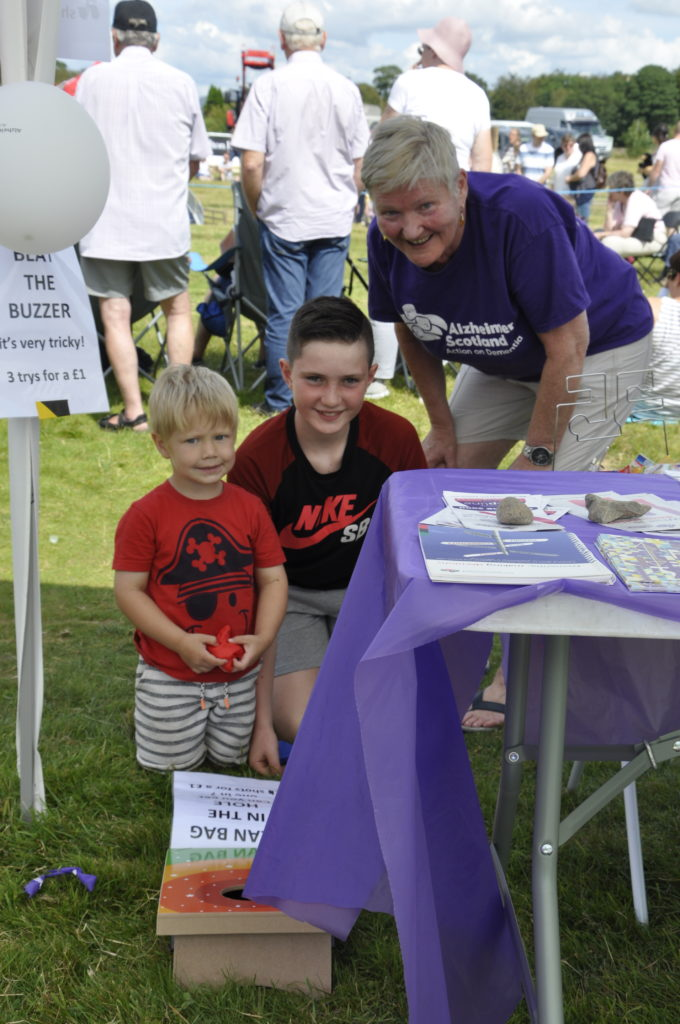 Sue Pagan from Oban Dementia Resource Centre with Brodie and George. 15_t32_LornShow09