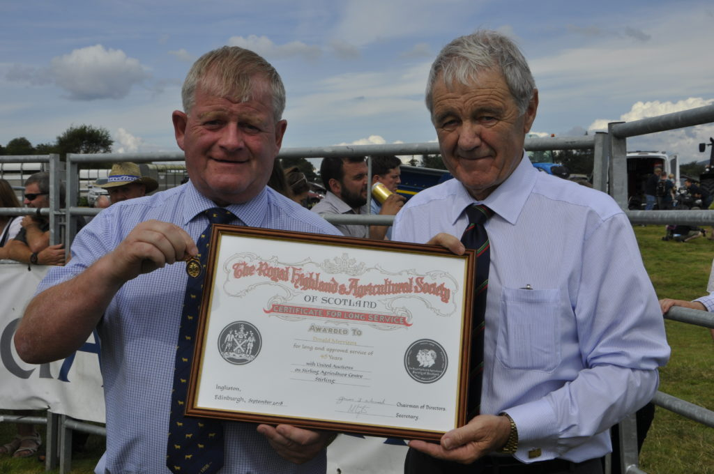 Ian McKerrell presents Donald Morrison with a certificate for long service. 15_t32_LornShow15