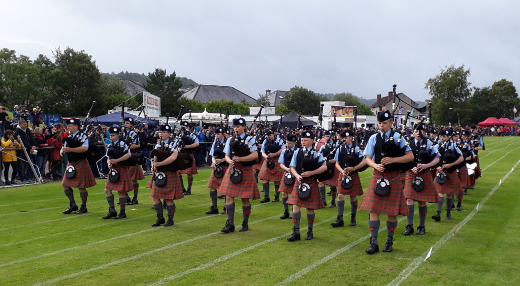 Oban High School Pipe Band parade around the Mossfield pitch.