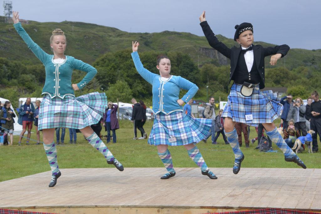 From left, dancers Abbie Keelly, Connie MacLennan, and Innes MacKenzie perform for the judges.  Photograph: Iain Ferguson, alba.photos