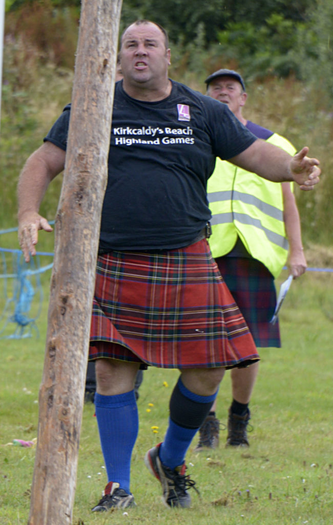 Heavy athlete, Peter Hart from Glenisla in action in the caber event. Photograph: Iain Ferguson, alba.photos
