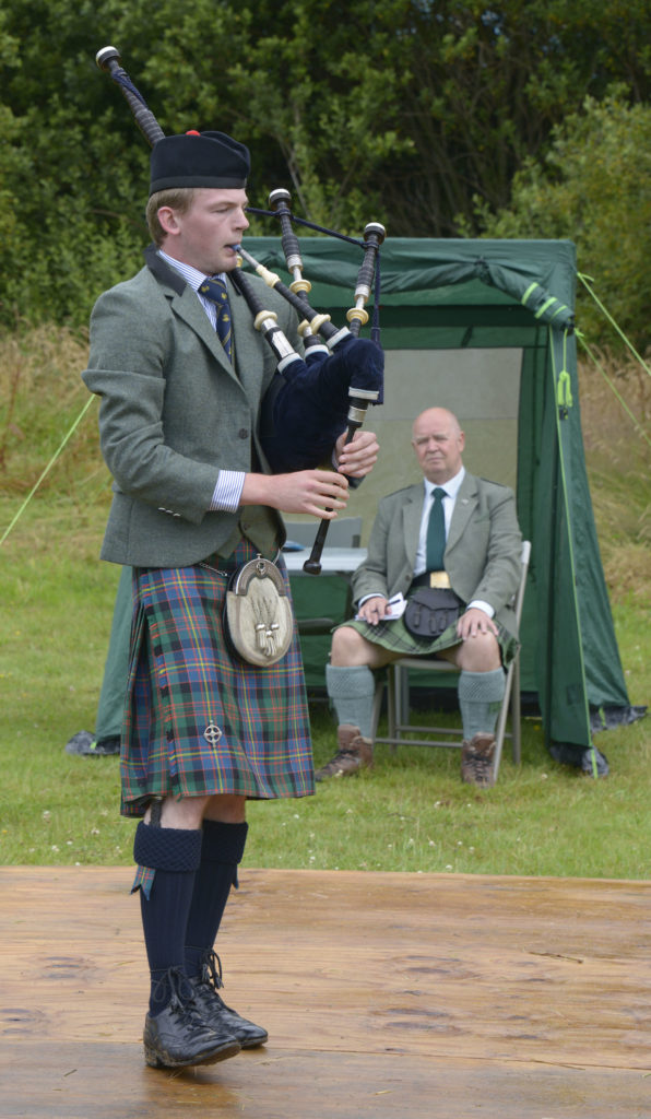 Fort William piper Sandy Cameron plays for judge Archie MacLean. Photograph: Iain Ferguson, alba.photos
