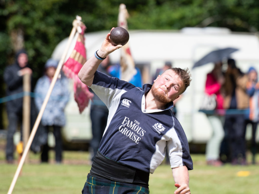 Heavies competitor Alasdair Davidson gives it his all in the shot put acton.   NO F34 Heavies - Alistair Davidson