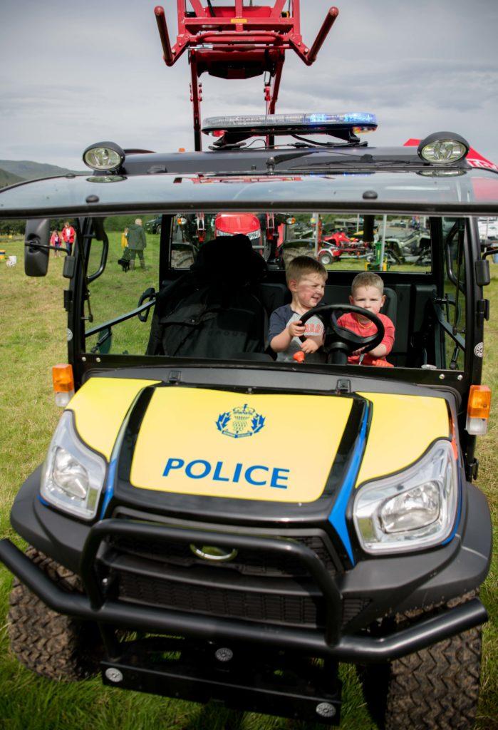 Spean Bridge brothers Ewen and Alec Kelly obviously enjoy a seat in the Police Scotland farm vehicle.  NO F35 LAS 2019 - Brothers Ewen & Alec Kelly from Spean bridge