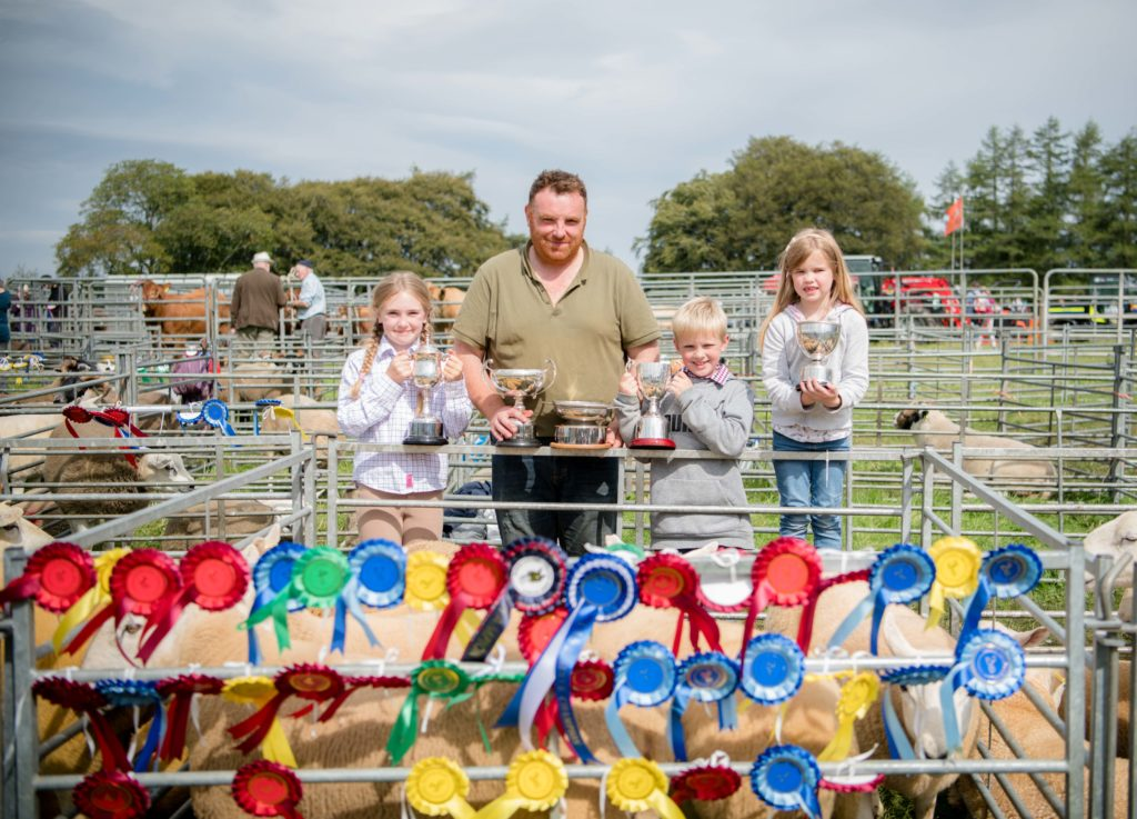 Martin Cameron, from Balmaglaster, Spean bridge, with his nieces and nephew  with trophies and ribbons from the sheep (other breeds) competition.  NO F35 LAS 2019 - Martin Cameron from Balmaglaster