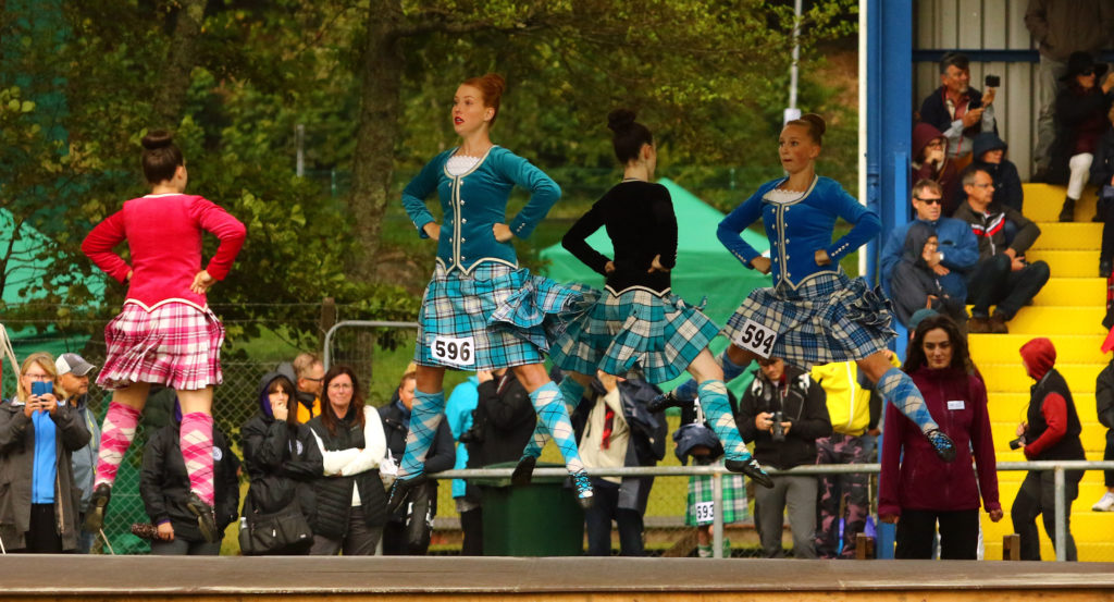 Highland dancers performed under cover from the rain.