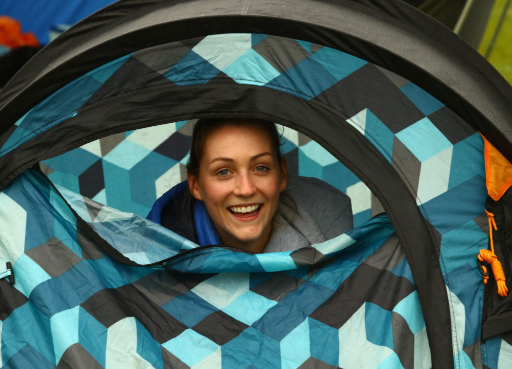 Athlete Emma Thomson from Oban shelters from the wind and rain between events.