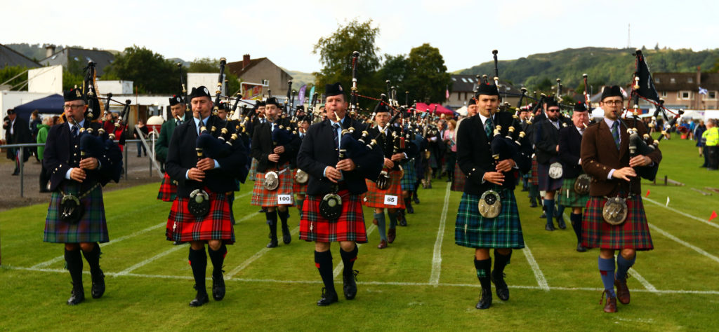 Prizewinning pipers march to the members' tent.