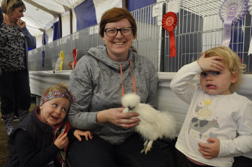 Lauren Paterson and daughters Aila and Morag with their six month old champion Silkie.