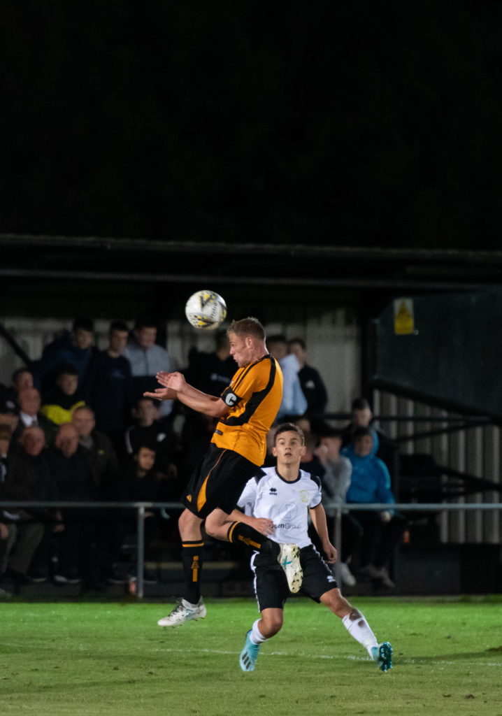 Captain Robert Nevison jumps high to beat his man. Photo: Abrightside Photography. NO F38 Fort Clach 02
