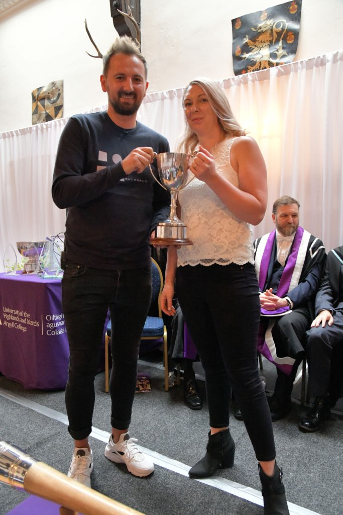 Kerry Anne Wallace receives the Mary Mackenzie Memorial Cup for Hairdressing.