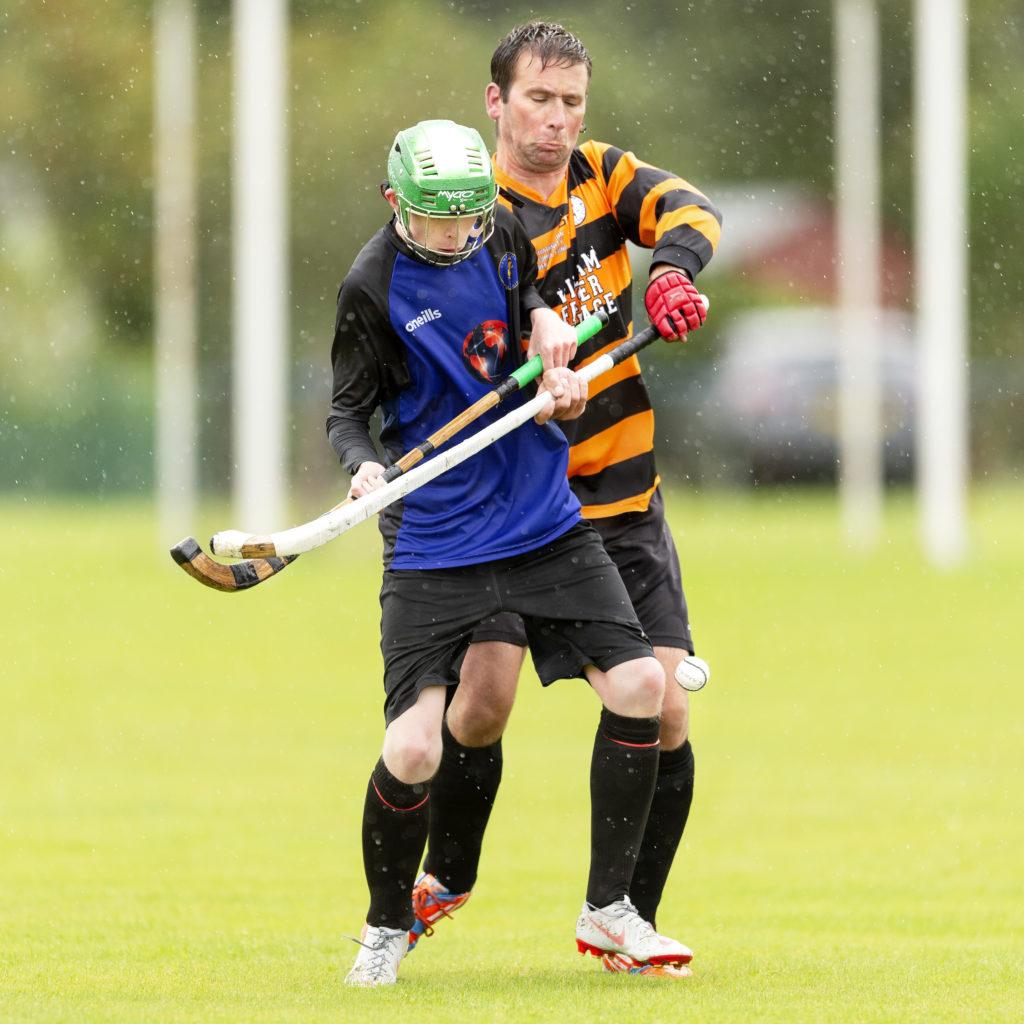 Kieran Macdonald, Lewis, shields the ball from Boleskine's Chris Cameron. Photograph: Neil Paterson.