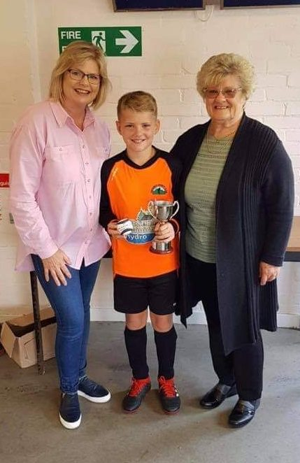 Iona and Mary MacMillan with Player of the Tournament Matthew Sloss.