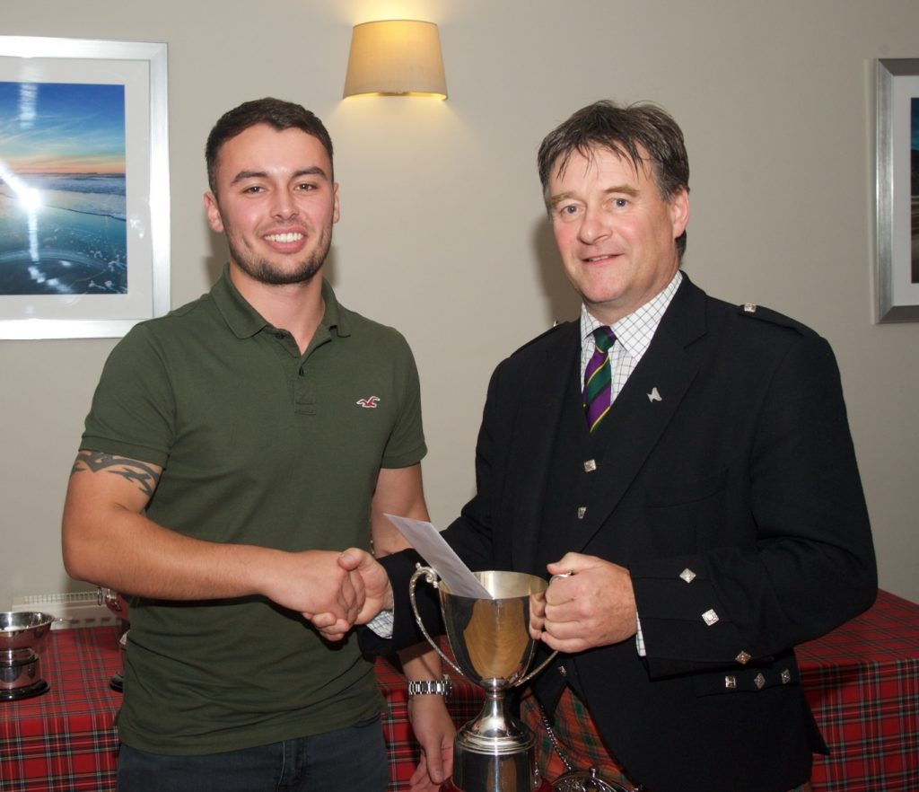 Campbell McFadyen, left, presents the McFadyen's Transport Ltd trophy for the 6/8 March (local composers) to Angus MacColl. Photograph: Stuart Andrew.
