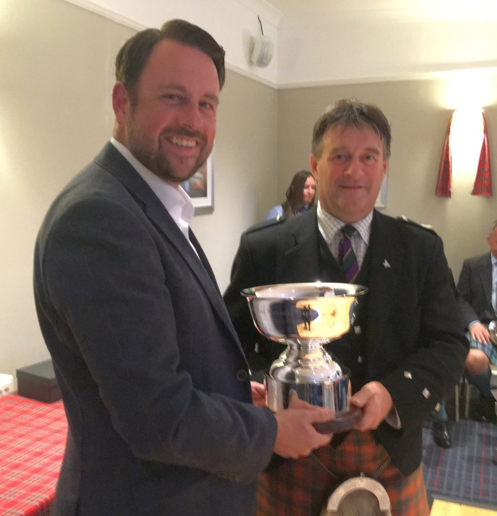Springbank Distillery's director of sales and marketing, Ranald Watson, presents Angus MacColl with the Willie McCallum Memorial Trophy.