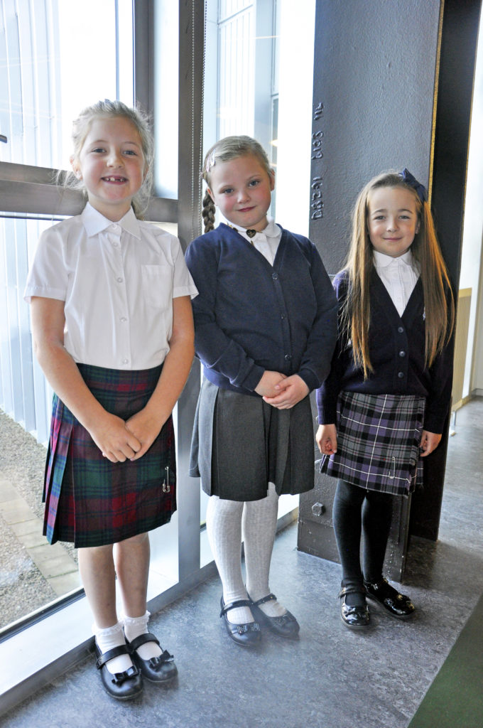 Right: Solo singers, left to right, eight-year-old Ella Fyfe from Sgoiltean Ceann Loch Gilp, and Carly Cranston and Sophie Philips, both aged seven, and pupils at Bun-sgoil Àird Driseig. 15_SN_ModMon_01