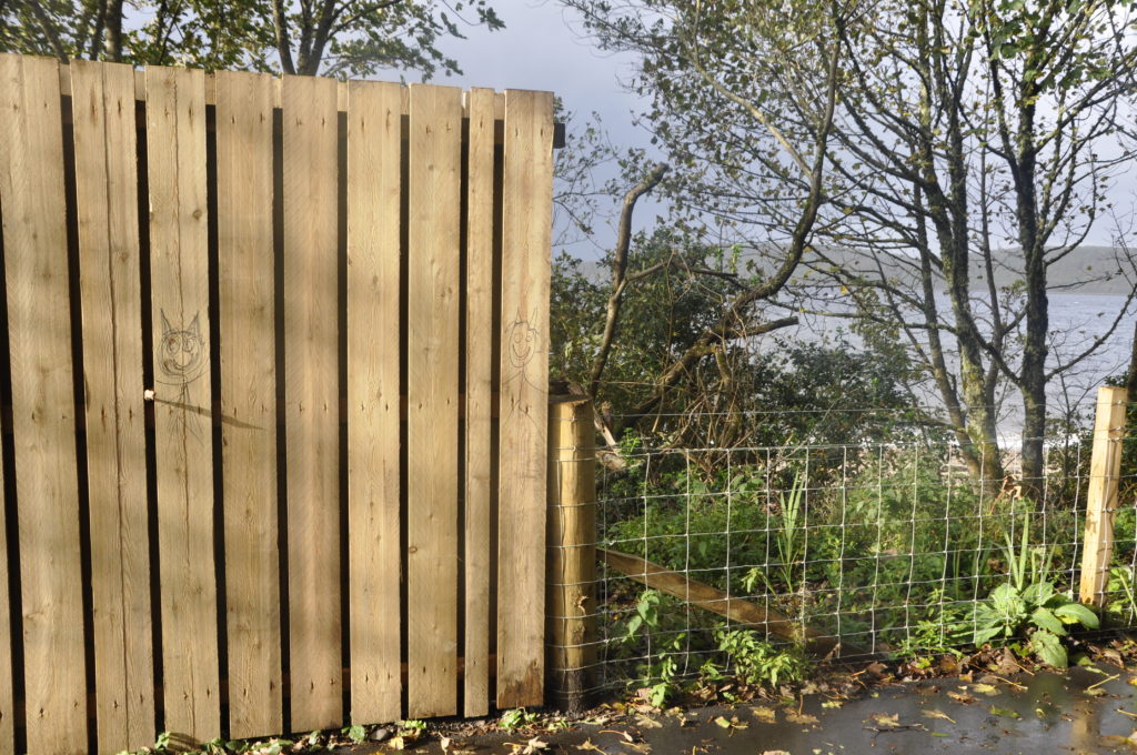 The high fence next to the Sustrans path from Ledaig towards Benderloch.