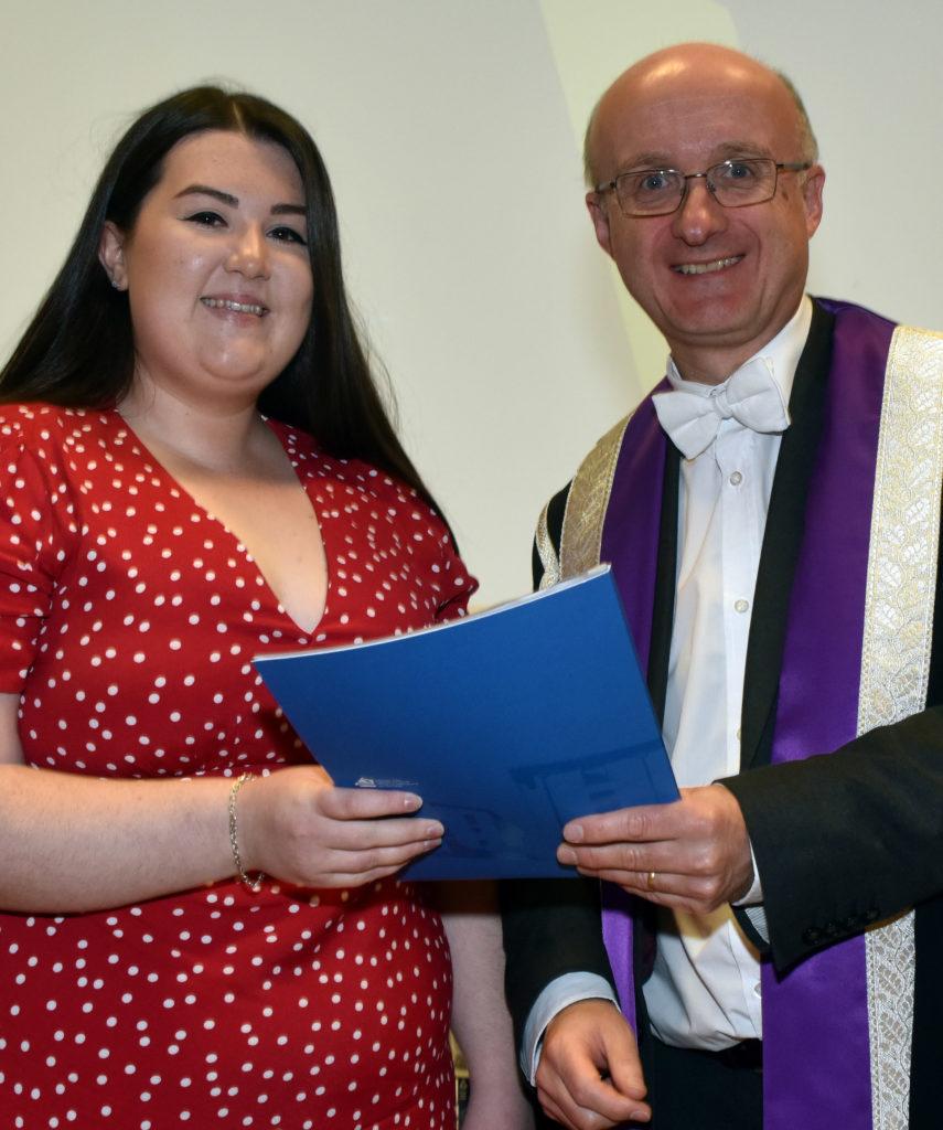 Shannon NicIlleathain – Oileanach SMO na Bliadhna -receives her award from Professor Neil Simco, Vice-principal of the UHI.  NO F42 Gaelic college graduation 01