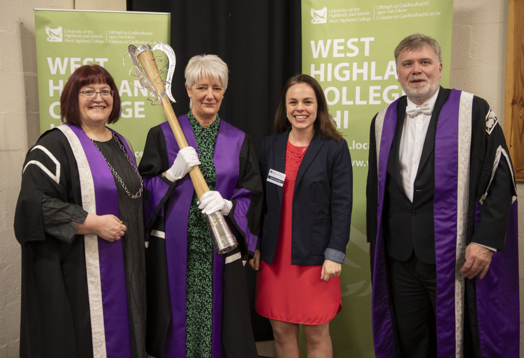 Guest speaker,  Kate Forbes MSP (second right) with Principal Lydia Rhomer (left), Mace bearer Myra McCabe and  Vice Chancellor, Crichton Lang. Photograph: Iain Ferguson, alba.photos  NO F42 WHC GRADUATION GUESTS
