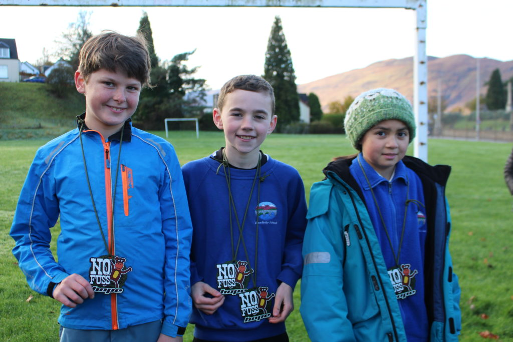Overall third place podium was the team From Spean Bridge Primary, from left, Alan Cameron, Ross Loughray and Shona Knight.  NO F45 triathlon 3rd Team - Spean Bridge