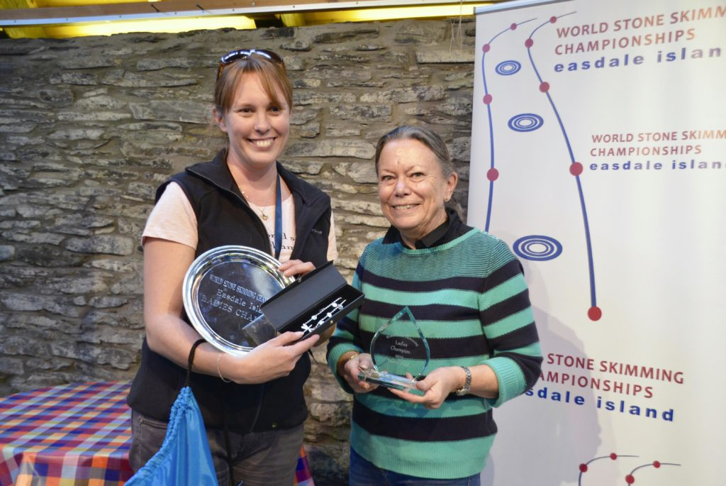 Ladies champion receiving her prize from category sponsor Margaret Temlett of Northern Retail. Margaret also made the silver necklace presented to our winning lady. Photograph: Jordan Young of LoveLiveRun.