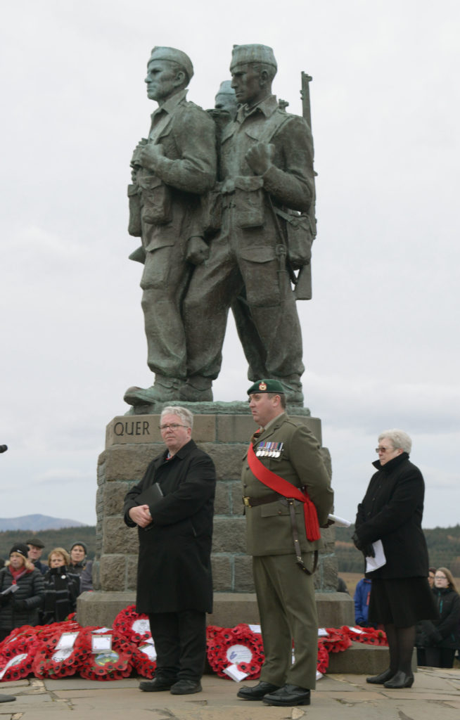 Local ministers Richard Baxter and Morag Muirhead, conducted the service at the Commando Memorial with Royal Marines Sgt Major Dermot Buckley Photograph:  Iain Ferguson, alba.photos  NO F46 Commando Mem ministers