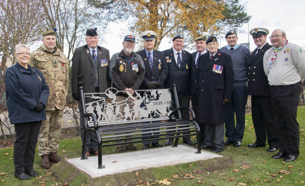 Representatives of the Royal British Legion Scotland and the local groups with the new memorial bench in The Parade in Fort William. Photograph: Iain Ferguson, alba.photos  NO F46 FW WAR MEMORIAL BENCH