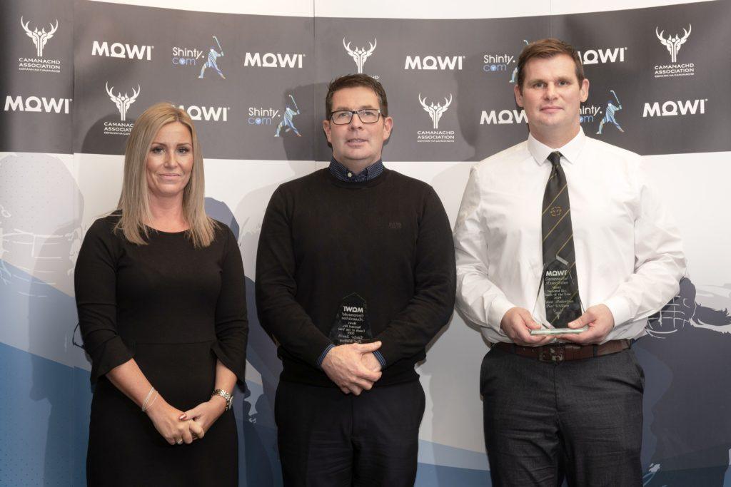 National Div. Coach of the Year Victor Smith (centre) and Addie Roberton (right) of Fort William receive the award from Mowi's Jayne Mackay.  Mowi Shinty Awards Luncheon and Conference at The Kingsmills Hotel, Inverness.