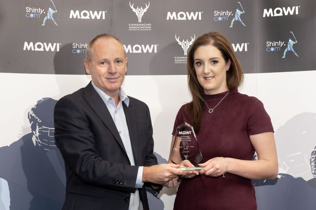 WCA North Div. 2 Team of the Year - Lovat - collected by Caroline MacLean who receives the award from Mowi's Angus Mackay.  Mowi Shinty Awards Luncheon and Conference at The Kingsmills Hotel, Inverness.