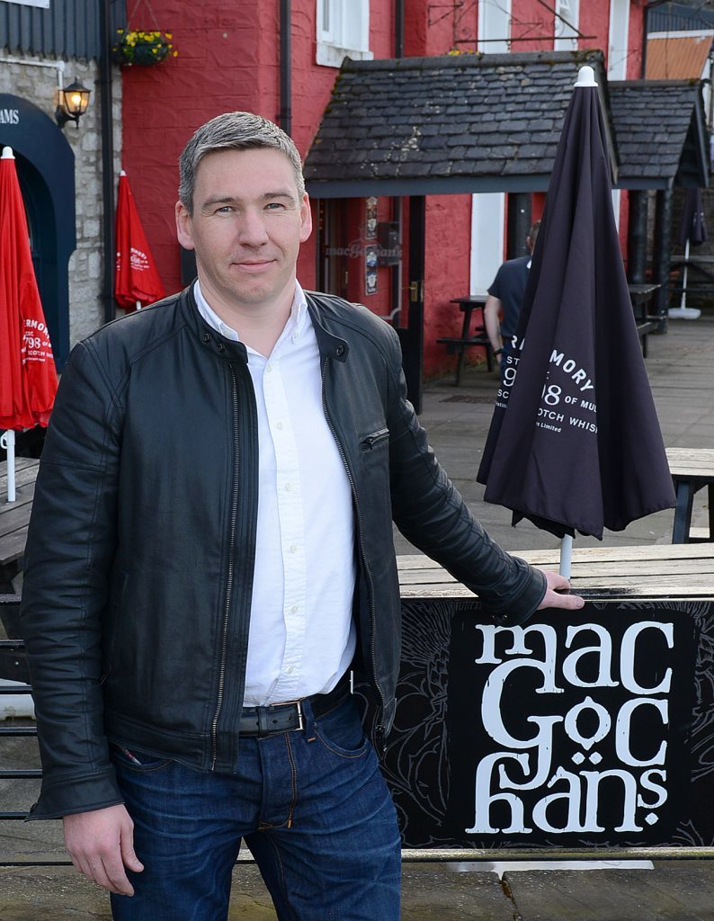 Pictured is Neil Morrison, proprietor of Macgochans in Tobermory.
