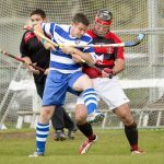 In front of the Glenurquhart goal: A tussle between Glen Mackintosh (Newtonmore) and John Barr (Glenurquhart).  Newtonmore v Glenurquhart, MacTavish Cup semi final, played at The Eilan, Newtonmore.