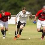 Lovat's Daniel Grieve (centre) leads the charge, with Michael Fraser (left) and John Barr (both Glenurquhart).  Lovat v Glenurquhart in the Tulloch Homes Camanachd Cup 2nd Round, played at Balgate, Kiltarlity.