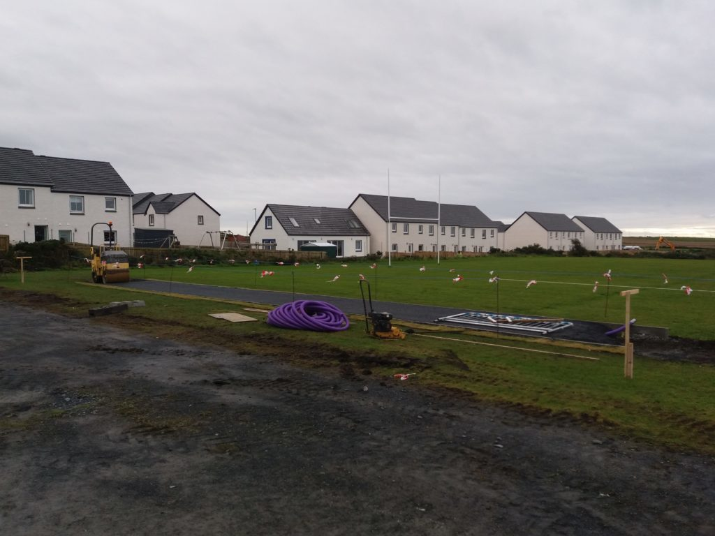 Goalposts move as path built through Islay rugby pitch