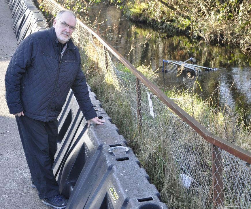Hands off the flood barrier, warns councillor