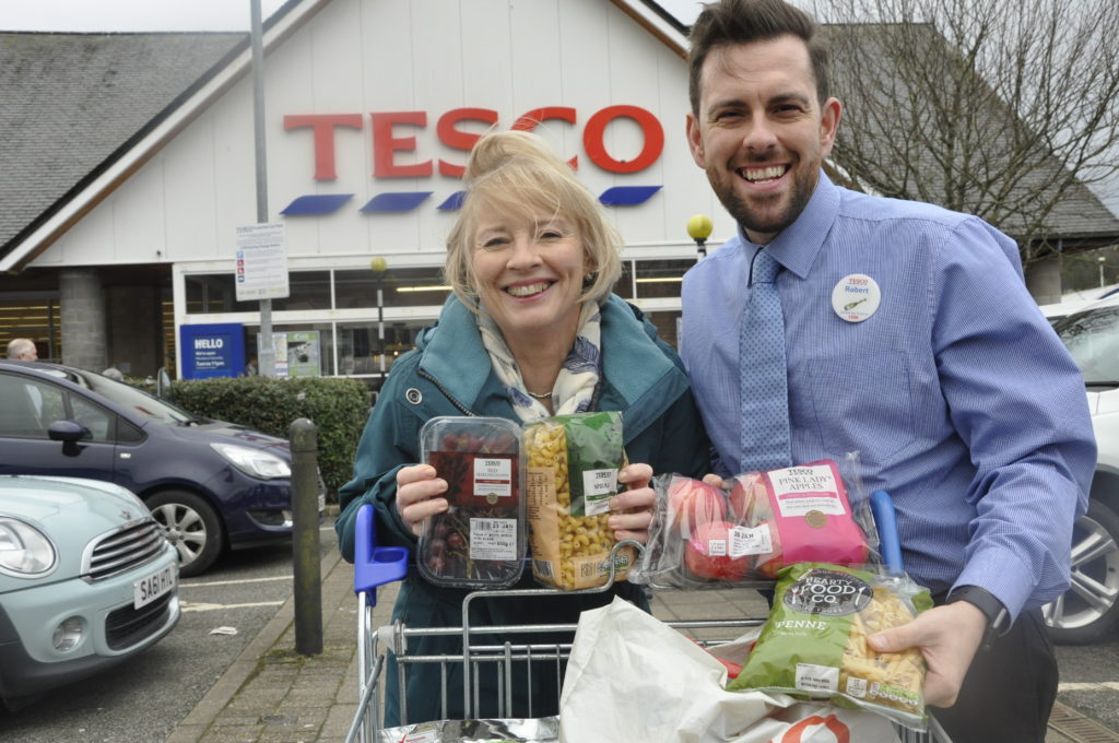 Trolley dash winner Liz shares her luck with charity