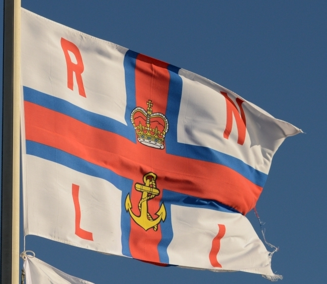 Half mast RNLI flag pays tribute to former crewman
