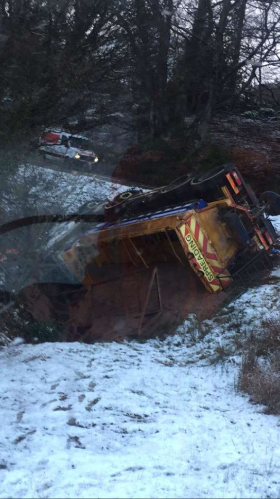Driver taken to hospital after gritter overturns on icy road