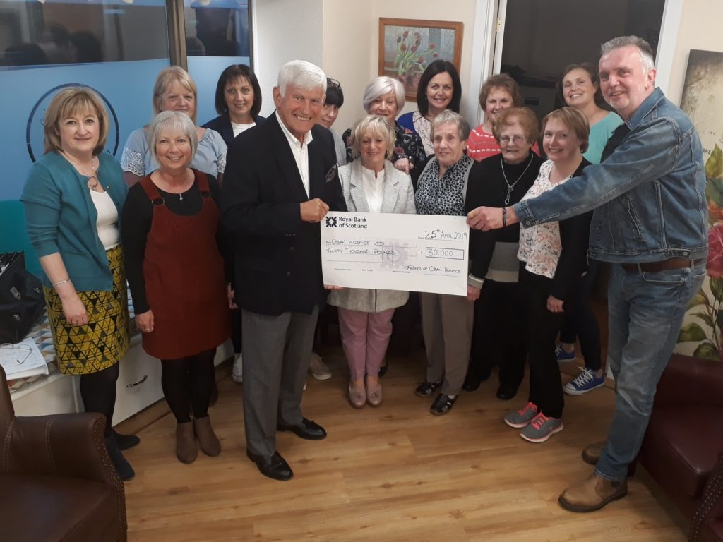 Friends hand over £30,000 to Dove Centre